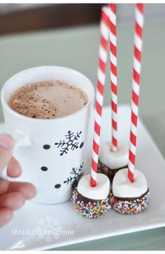 Hot Chocolate dippers…  melt some chocolate in a bowl, stick marshmallows on straws and dip them in the chocolate and some sprinkles.  The marshmallows will melt in your hot cocoa, leaving some yummy, ooey, gooey goodness!