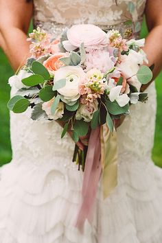 Bouquet with Ranunculus, Garden Roses, Peonies, and Olive Leaf | Brides.com