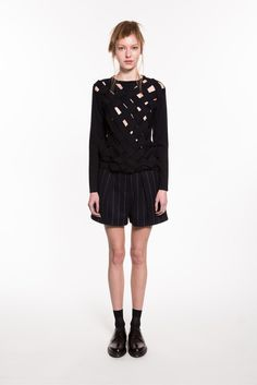 Ji Oh | Fall 2015 Ready-to-Wear | 04 Black cut out long sleeve top and pinstriped shorts