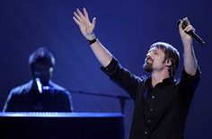 THIRD DAY: Lead singer Mac Powell, shown performing at the Dove Awards in 2006, led the band through a powerful set at the House of Blues in Anaheim on Thursday night. Description from ocregister.com. I searched for this on bing.com/images
