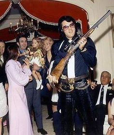 December 28, 1970 Elvis showing off his guns. Elvis Is Best Man At Sonny West's Wedding. After A Church Reception There Was A Second Reception At Graceland. TCB⚡with TLC⚡