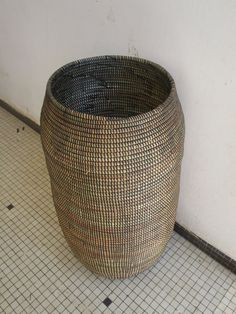 A slender black zen style handwoven Basket with natural grass shining through. This Yoga Mat Holder is ready to be shipped to your home. No matter where you live you can use this versatile Basket in many ways, for umbrellas, paper rolls and mats. It will hold about yoga mats 3 mats. The diameter is 26 cm so you can measure your mats to see exactly.!! It would be also large enough in diameter to hold one extra large, extra thick Pilates Mat!! It would look fantastic to place several next to…
