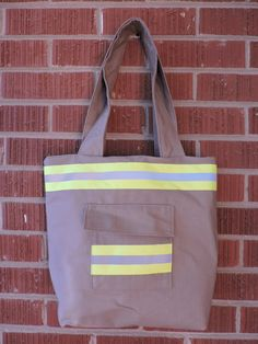 This purse is perfect for any firefighter or firefighter wife Are you a proud Fire Fighters Wife?!! Then you NEED this purse!! MATERIALS This purse is made from new cotton rip stop material. This material looks just like the firefighter turnout material. I choose to use new material