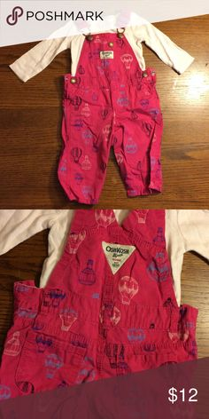 Girl's OshKosh bibs Pink OshKosh overalls with printed hot air balloons. Original matching shirt. Super cute! Worn once. 6m OshKosh B'gosh Bottoms Jumpsuits & Rompers