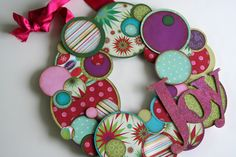 Colorful paper wreath... maybe use old Christmas cards?