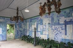 Hand-painted tiles decorate the covered colonnade dining area
