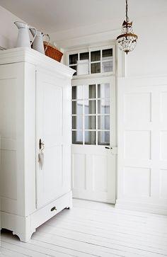 love this huge cupboard   ~~~I love the door/transom window combo