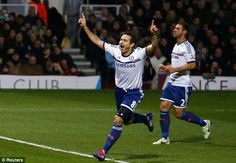 Chelseafc Frank Lampard (centre) celebrates after scoring his penalty against West Ham United