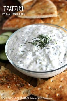 Tzatziki is a deliciously fresh and easy dip with yogurt, cucumber, lemon and dill. Totally irresistible on pita, chicken and cooked or raw veggies (and it's good for you too)!