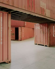 Venice architecture studio AMAA has installed eight shipping containers in an Italian factory as a permanent installation that aims to investigate what architecture is.