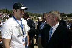 LIGHTING CEREMONY OF THE OLYMPIC FLAME Credit: Getty Images OLYMPIA, GREECE - SEPTEMBER 29: Second torchbearer Alexander Ovechkin of Russia, left, professional ice hockey winger and captain of the Washington Capitals with IOC President Thomas Bachl at Ancient Olympia during the lighting ceremony of the Olympic Flame for the Sochi 2014 Winter Olympic Games at Ancient Olympia on September 29, 2013 in Olympia, Greece. (Photo by Milos Bicanski/Getty Images)