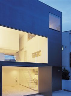 The Japanese have really mastered #minimalistic #architecture. These ceiling to floor windows and doors welcome you inside, and helps softens the boxy exterior. #Japan #KojiTsutsui #house #design