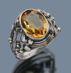 BERNARD INSTONE 1891-1987  Arts & Crafts Ring   Silver Citrine  H: 1.5 cm (0.59 in)   Ring Size:  |UK:M|  |US:6.25|  |EU:52.5|  |Asia:12|  Marks: 'Sterling'  British, c.1930