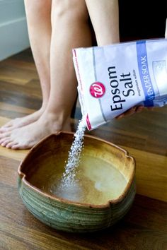 Grab a pair of nail clippers and cut your nails to the desired length and shape. Fill a basin with warm water, then add in one cup epsom salt, one teaspoon of baking soda, and four or five drops of essential oil, then stir together.