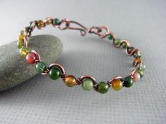 Hey, I found this really awesome Etsy listing at https://www.etsy.com/listing/204350018/wire-wrapped-bracelet-fancy-jasper-and