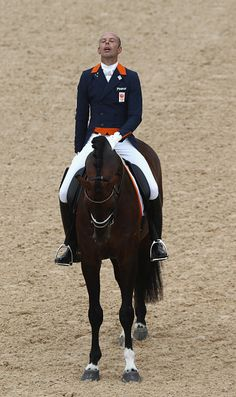 #RIO2016 Hans Peter Minderhoud of the Netherlands riding Johnson celebrates during the final day of the Dressage Grand Prix event on Day 7 of the Rio 2016...