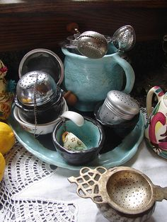 Reminds me of my collection of tea strainers Tea Strainer, Tea Infuser, Tea Kettles, Cuppa Tea, Tea Sandwiches, Tea Art, Tea Caddy, My Cup Of Tea, Tea Service