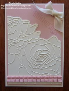 lovely card with embossed roses...rose panel cut out to outline the large roses...