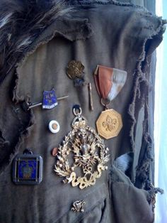 broaches, medals and pins.