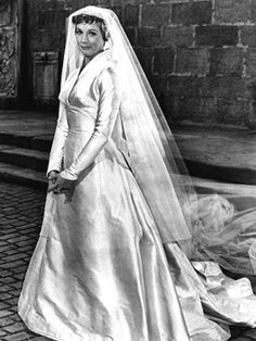 Pin for Later: The 30 Most Iconic Film Wedding Dresses of All Time The Sound of Music Maria (Julie Andrews) marries Captain Von Trapp (Christopher Plummer) in Austria's Salzburg Cathedral in a stiff, formal gown with a high collar.