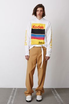 Could maybe do without the text on the sleeves but I like the logo... Opening Ceremony Fall 2015 Menswear