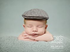 Tallahassee baby and family photographer, Linda Long with Long's Photography, creates newborn images of adorable baby boy with dapper grey hat cap on light blue snuggle soft blanket