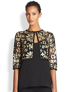 Harrison Morgan Bolero. Gold floral sequins on a light weight net background.  This perfect piece to any wardrobe will take you from day to evening! Www.saks.com