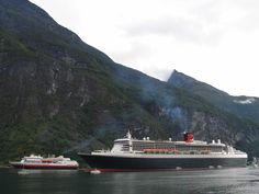 Queen Mary 2 sails down the Norwegian Fjords.