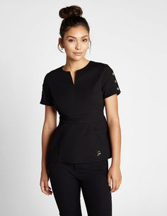 The Button Sleeve Top in Black is a contemporary addition to women& medical scrub outfits. Shop Jaanuu for scrubs, lab coats and other medical apparel. Cute Scrubs Uniform, Scrubs Outfit, Spa Uniform, Scrubs For Sale, Stylish Scrubs, Medical Scrubs, Nursing Scrubs, Black Scrubs, Womens Scrubs