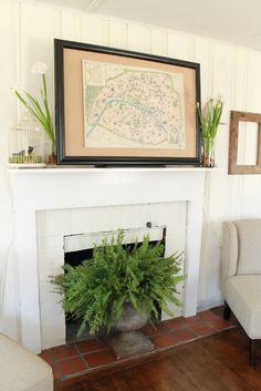 I love the fern in front of the fireplace in the antique urn.  So warm
