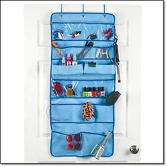 """HAIR & ACCESSORIES ORGANIZER-44"""" H X 20"""" W.  Holds your hair ties, barrettes, mousse, gels, etc.  Hook on side for handing hair dryer.  Mounts easily over door.  Polyester, plastic.  Order at www.youravon.com/jfreemyers"""