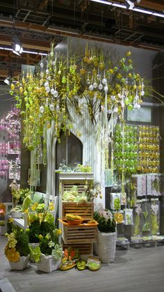 If I ever had a shop of my own, i would have a tree like this and decorate it according to each season/holiday. :)