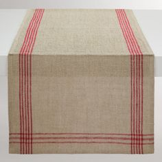 Woven of 100% linen, our exclusive runner features red stripes that intersect to form plaid-patterned corners. Layer them with our coordinating placemats and napkins for a natural look with a festive pop of color.