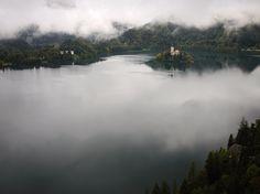 A small island peaks through the fog at Lake Bled in northwestern Slovenia. [Photo by Lindsay Mackenzie, Redux]