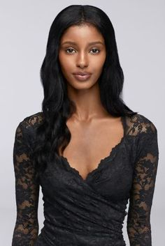 Beautiful floral lace with a hint of stretch is the foundation for this gorgeous dress, which is finished with a elegant scalloped neckline and long sheer lace sleeves.  By Onyx Nites  Nylon, rayon, spandex  Back zipper; fully lined  Hand wash  Imported