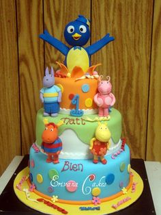 I like this cake for her backyardigans themed birthday.