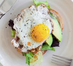 Recipe with video instructions: Healthy, quick breakfast option for those egg-lovers Ingredients: 1 slice of sourdough, sprouted, or gluten-free bread, a small handful of arugula or mixed greens, cleaned, 1/2 avocado, cubed, salt, pepper, 1 good quality egg, and any type of hot sauce