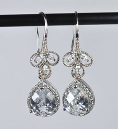 Are you able to buy the top portion of these earrings and attach a stone the color of the dresses?   Glamorous Fine Jewellery Silver Bridal by RomanceInSilverBride, $40.00