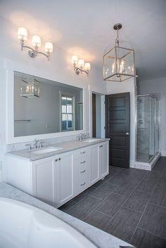 White Bathroom Ideas, Polished Nickel Fixtures, Grey Marble Bath Surround And Countertops, And Dark Tile Floors - Home Interior Design Ideas Grey Bathroom Floor, Dark Gray Bathroom, Bathroom Flooring, Bathroom Marble, Modern Bathroom, Gray And White Bathroom Ideas, Gray Floor, Small Bathroom, Mirror Bathroom
