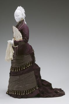 AFTERNOON DRESS CIRCA 1878-1879 Maison Leonie Dumonteuil, France Silk taffeta, brocatelle, fringe, tassels 1992.19A-B Mint Museum - Collection Database - Fashion - Afternoon Dress