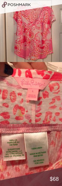 """Lilly Pulitzer Duval Linen Top Lilly Pulitzer Duval linen top. Size large. Hot coral """"Trunk in Love"""" elephant pattern is so cute! V-neck notched top has cap sleeves, curved hem, and pocket detail. 100% linen. Hand wash in cold water. Excellent condition! Super fast shipping on all my items! Offers are welcome by using the blue offer button! See tons more Lilly in my closet! I offer bundle discounts! Lilly Pulitzer Tops Tees - Short Sleeve"""
