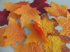 100 MULTI COLOURED AUTUMN LEAVES WEDDING/ DECORATION/CRAFT/ART/COSTUMES/CONFETTI