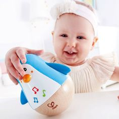 The Hape Penguin Musical Wobbler guarantees total delight for baby. They will love to make this penguin pal waddle, spin, rock and roll. Soothing, tinkling sounds awaken baby to the joy of music. Infant Activities, Book Activities, Sitting Up Baby, Best Toddler Toys, Wooden Baby Toys, Musical Toys, Craft Projects For Kids, Activity Centers, Kids Education