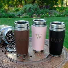 Whether they like their coffee steaming hot or ice cold, they'll love this Personalized Executive Travel Tumbler. This classy travel mug features a leather-look exterior with attractive edge stitching and is available in three rich colors. Great for the office, home, or on the road, the mug includes a sturdy cap and stainless accents. The soft vinyl cuff is removable for easy washing.
