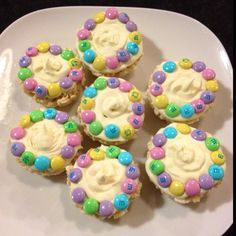 Rice Krispies Cupcakes!  Rice Krispie treats in a muffin tin Cream cheese frosting Easter M&Ms