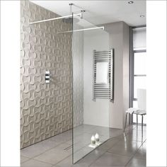 Create a feature with a textured wall tile and combine with a brushed chrome finish frameless glass walk through shower screen for a elegant bathroom design.