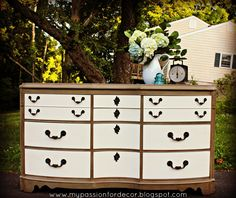 Color scheme--yes please! Might add the dark waxed look or a tan detail to the cream drawers. Also could replace 2 middle, lower drawers with baskets?