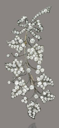 TWO ANTIQUE DIAMOND BROOCHES Designed as a larger and a smaller branch of ivy leaves, the larger one with a tied ribbon at the base, both set throughout with old-cut diamonds, spring adapted, mounted in silver and gold, circa 1870, 12.8 and 9.6 cm #DiamondBrooches