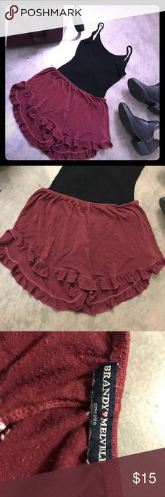 Maroon Brandy Melville shorts Super cute classic Brandy ruffle shorts not damaged but clear worn- these will be your new favorite pair I promise Brandy Melville Shorts