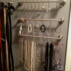 Organized Jewelry using towel racks and shower hooks in my closet. Genius!